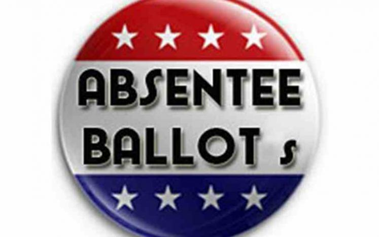 red white and blue circle with wording ABSENTEE BALLOT