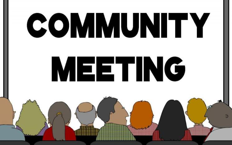 community meeting with people in forefront