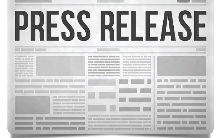 Black and White Photo of Newspaper with heading Press Release