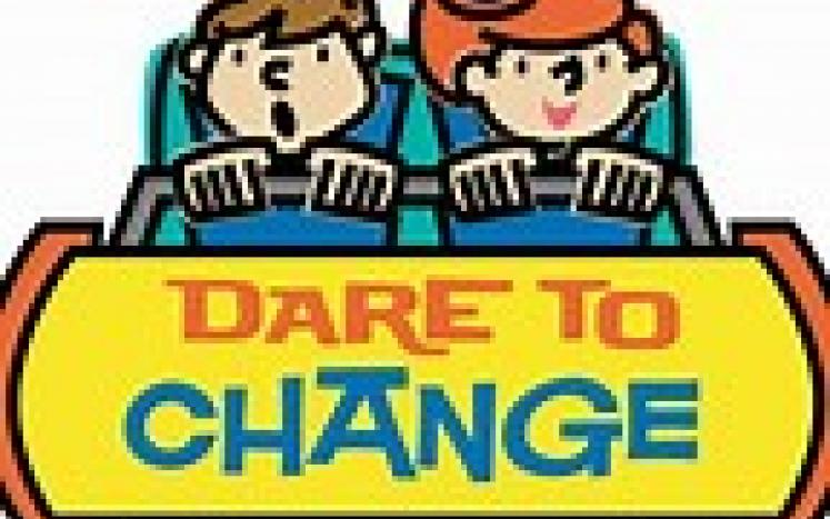 two people in a care with DARE TO CHANGE