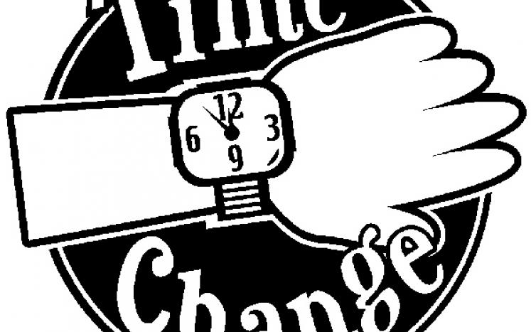 black and white  circle showing wrist with a watch and wording TIME CHANGE